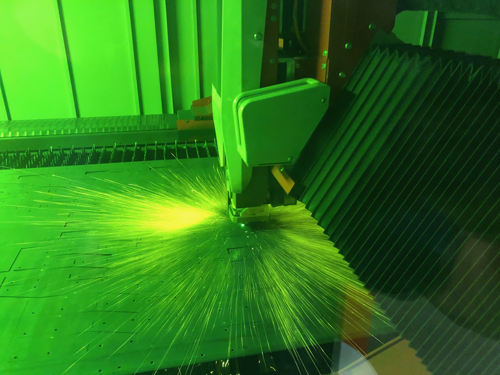 Laser cutting metal part for fabrication